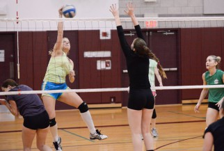 women's volleyball game action