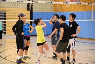 Players enjoying nyc coed volleyball league game
