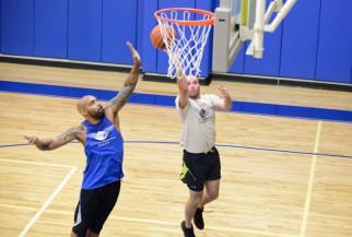 Basketball player blocks shot