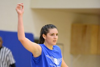 women's basketball player on blue team.