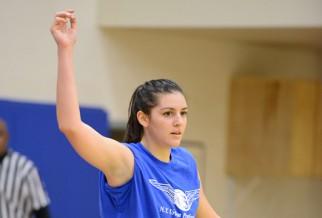 women's basketball player on blue team.