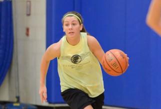 Intense woman basketball player