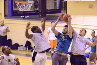 Player getting fouled in basketball league game.