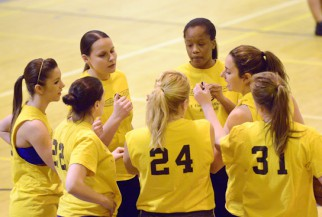women huddle in Basketball game