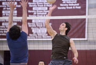 Male Volleyball Player Dinks ball