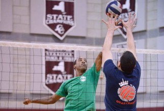 Intense net action in men's volleyball game