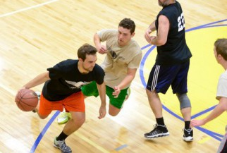 Player in black with the ball in big game in nyc basketball league