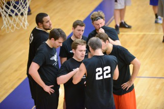 Team plans attack in Nyc basketball league game.