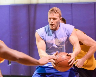 Player fights for the ball in Summer basketball league game