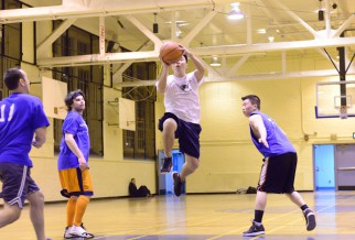 Player jumps high in NYC summer basketball league