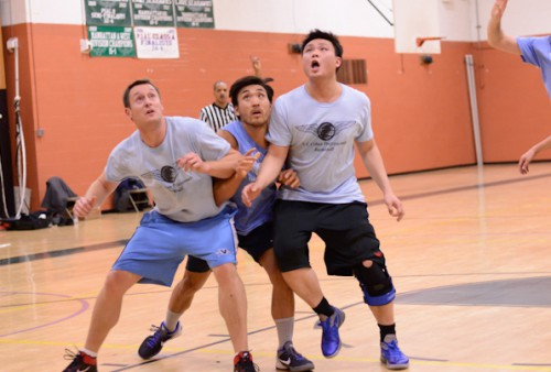 Players fight for rebound in Nyc basketball league game