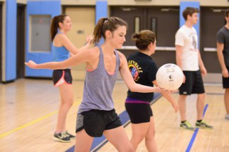 Young woman preparing to serve volleyball