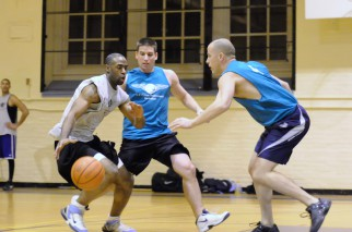 Men play hard defense in basketball