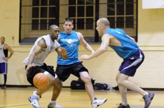 Men play hard defense in basketball