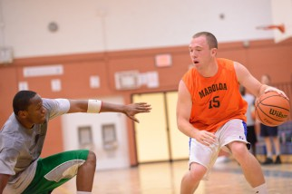 Marolda controls the ball in Nyc Basketball league game