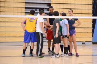Volleyball team huddles in Nyc coed volleyball league game
