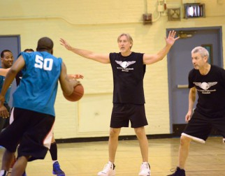 playing defense in men's over 40 basketball league