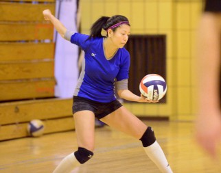 player prepares to serve ball