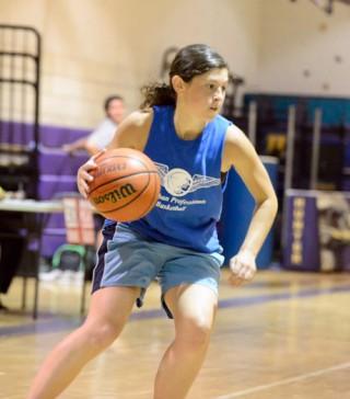 woman dribbling basketball