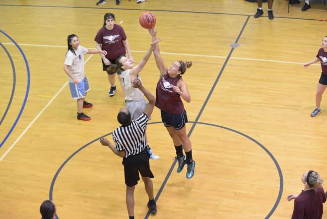 ladies basketball game tip off