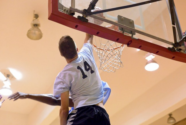 player dunks the ball