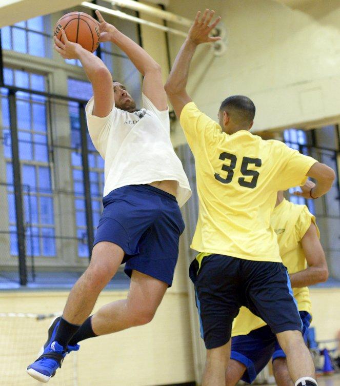 player shoots basketball